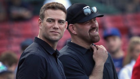 BOSTON - APRIL 28: Chicago Cubs President of Baseball Operations, Theo Epstein and former Boston Red Sox Kevin Youkilis  take in the scene before the game.  The Boston Red Sox host the Chicago Cubs in the first of a three game series at Fenway Park in Boston on April 28, 2017. (Photo by Barry Chin/The Boston Globe via Getty Images)
