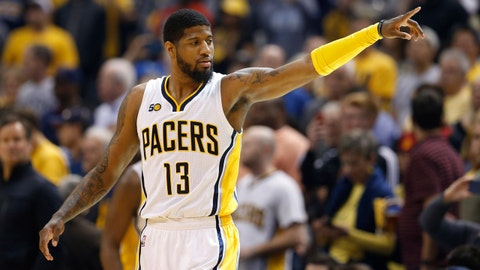 Apr 23, 2017; Indianapolis, IN, USA; Indiana Pacers forward Paul George (13) points during a game against the Cleveland Cavaliers in game four of the first round of the 2017 NBA Playoffs at Bankers Life Fieldhouse. Cleveland defeats Indiana 106-102. Mandatory Credit: Brian Spurlock-USA TODAY Sports