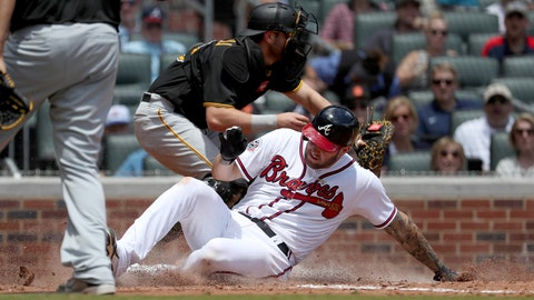 May 25, 2017; Atlanta, GA, USA; Atlanta Braves first baseman Matt Adams (18) scores a run ahead of the tag by Pittsburgh Pirates catcher Francisco Cervelli (29) on a single by Braves third baseman Rio Ruiz (not pictured) in the seventh inning at SunTrust Park. Mandatory Credit: Jason Getz-USA TODAY Sports