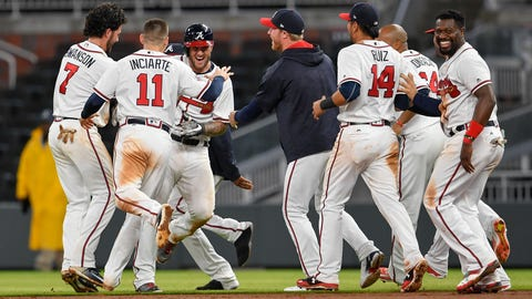 May 23, 2017; Atlanta, GA, USA; Atlanta Braves first baseman Matt Adams (18) (third from left) reacts with team mates after delivering the game winning hit against the Pittsburgh Pirates during the ninth inning at SunTrust Park. Mandatory Credit: Dale Zanine-USA TODAY Sports