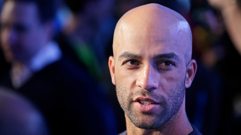 Former tennis star James Blake talks with reporters during a news conference in New York, Wednesday, Oct. 28, 2015. Blake is planning to take part in the marathon on Sunday, Nov. 1, 2015. (AP Photo/Seth Wenig)