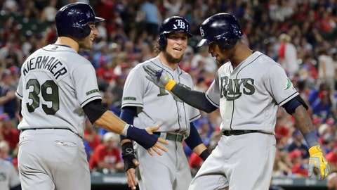Tampa Bay Rays Kevin Kiermaier (39) and Colby Rasmus (28) greet Tim Beckham (1) at home after Beckham's three-run home run against the Texas Rangers in the seventh inning of a baseball game in Arlington, Texas, Monday, May 29, 2017.(AP Photo/Richard W. Rodriguez)