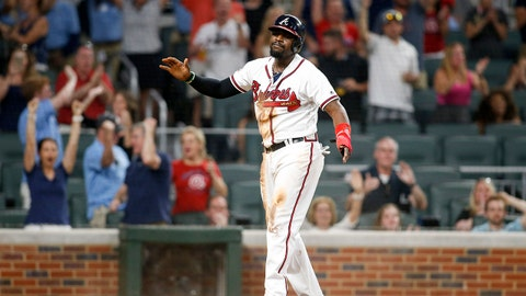 May 19, 2017; Atlanta, GA, USA; Atlanta Braves second baseman Brandon Phillips (4) reacts after scoring a run against the Washington Nationals in the eighth inning at SunTrust Park. Mandatory Credit: Brett Davis-USA TODAY Sports