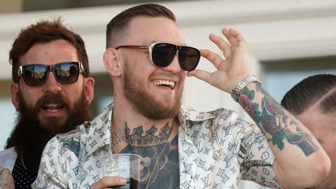 LIVERPOOL, UNITED KINGDOM - APRIL 08: (EMBARGOED FOR PUBLICATION IN UK NEWSPAPERS UNTIL 48 HOURS AFTER CREATE DATE AND TIME) Conor McGregor, current UFC Lightweight Champion,  watches the racing as he attends day 3 'Grand National Day' of the Randox Health Grand National Festival at Aintree Racecourse on April 8, 2017 in Liverpool, England. (Photo by Max Mumby/Indigo/Getty Images)