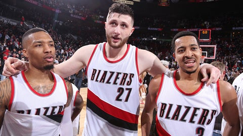 PORTLAND, OR - MARCH 9: Damian Lillard #0, Jusuf Nurkic #27 and CJ McCollum #3 of the Portland Trail Blazers celebrate a win against the Philadelphia 76ers on March 9, 2017 at the Moda Center in Portland, Oregon. NOTE TO USER: User expressly acknowledges and agrees that, by downloading and or using this Photograph, user is consenting to the terms and conditions of the Getty Images License Agreement. Mandatory Copyright Notice: Copyright 2017 NBAE (Photo by Sam Forencich/NBAE via Getty Images)