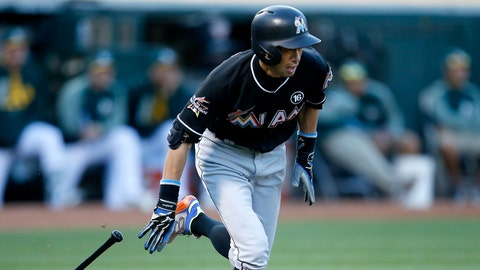 Miami Marlins' Ichiro Suzuki (51) hits a single to drive in 2-runs against the Oakland Athletics during the second inning of a baseball game on Tuesday, May 23, 2017 in Oakland, Calif. (AP Photo/Tony Avelar)