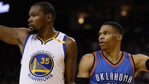 OAKLAND, CA - JANUARY 18:  Kevin Durant #35 of the Golden State Warriors and Russell Westbrook #0 of the Oklahoma City Thunder point in different directions after the ball went out of bounds at ORACLE Arena on January 18, 2017 in Oakland, California.  NOTE TO USER: User expressly acknowledges and agrees that, by downloading and or using this photograph, User is consenting to the terms and conditions of the Getty Images License Agreement.  (Photo by Ezra Shaw/Getty Images)