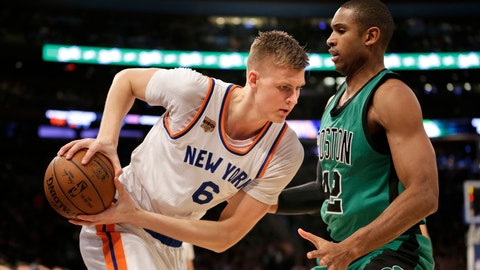 New York Knicks' Kristaps Porzingis, left, moves against Boston Celtics' Al Horford during the first half of the NBA basketball game, Sunday, April 2, 2017, in New York. (AP Photo/Seth Wenig)