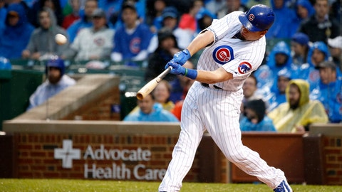 Chicago Cubs' Kyle Schwarber hits a home run off San Francisco Giants starting pitcher Johnny Cueto during the first inning of a baseball game Tuesday, May 23, 2017, in Chicago. (AP Photo/Charles Rex Arbogast)