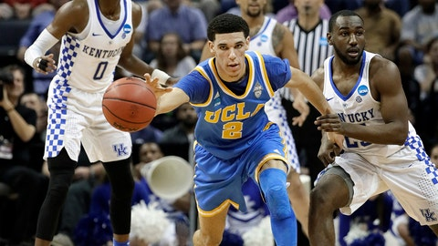 UCLA guard Lonzo Ball (2) dribbles away from Kentucky guard Dominique Hawkins, right, in the first half of an NCAA college basketball tournament South Regional semifinal game Friday, March 24, 2017, in Memphis, Tenn. (AP Photo/Mark Humphrey)