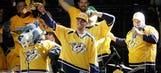 Catfish-toting Taylor Lewan, Titans adding to Predators madness in Nashville