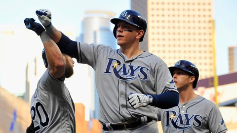 MINNEAPOLIS, MN - MAY 26: Steven Souza Jr. #20 of the Tampa Bay Rays congratulates teammates Logan Morrison #7 and Corey Dickerson #10 of the Tampa Bay Rays on scoring against the Minnesota Twins on a two-run home run by Morrison during the fourth inning of the game on May 26, 2017 at Target Field in Minneapolis, Minnesota. (Photo by Hannah Foslien/Getty Images)