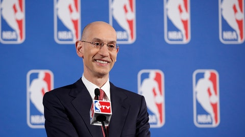 FILE - In this May 20, 2014, file photo, NBA Commissioner Adam Silver answers questions from the media during a news conference before the NBA Draft Lottery in New York. Speaking to The Associated Press on Friday, June 6, 2014, at an NBA Cares event, Silver said he's thrilled that the league's attention can be on the championship series between the Miami Heat and San Antonio Spurs _ and not, as it was for so much of the postseason, on the off-the-court matters involving the banishment of Los Angeles Clippers owner Donald Sterling and now the looming sale of that franchise. (AP Photo/Kathy Willens, File)