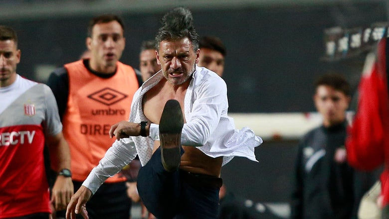 Watch coach lose his mind and rip his shirt off Hulk-style after bad call