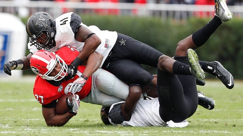 Georgia running back Nick Chubb (27) is brought down by Vanderbilt 's Mack Weaver (8) and Zach Cunningham (41) after a short gain in the first half of an NCAA college football game Saturday, Oct. 15, 2016, in Athens, Ga. (AP Photo/John Bazemore)