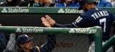 Brewers fight through two-hour rain delay to beat Cubs