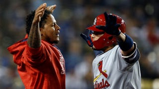 WATCH: Molina extends hit streak to 13 games with homer