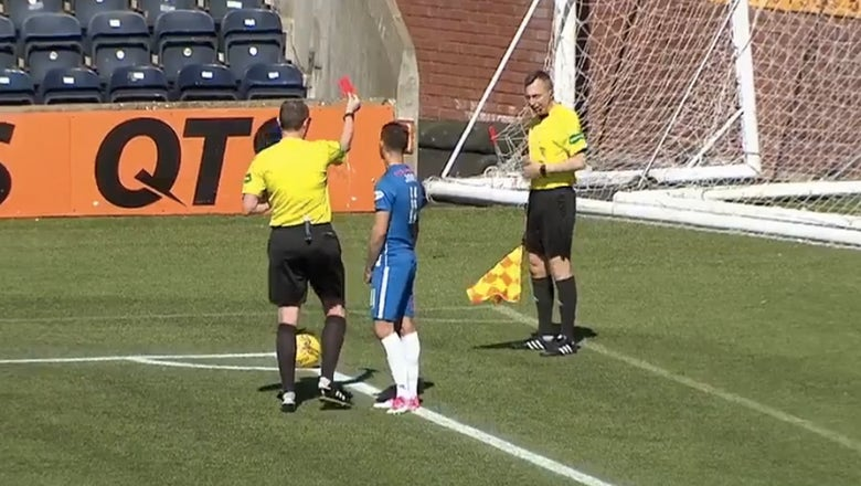 Referee red cards his linesman after a gross scene on the sidelines