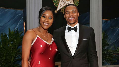 OKLAHOMA CITY, OK - NOVEMBER 17:  Russell Westbrook #0 of the Oklahoma City Thunder poses for a photo with his wife, Nina Ann-Marie Westbrook, before he is inducted into the Oklahoma Hall of Fame on November 17, 2016 at the Cox Convention Center in Oklahoma City, Oklahoma. NOTE TO USER: User expressly acknowledges and agrees that, by downloading and or using this Photograph, user is consenting to the terms and conditions of the Getty Images License Agreement. Mandatory Copyright Notice: Copyright 2016 NBAE (Photo by Layne Murdoch/NBAE via Getty Images)