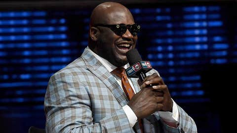 """LAS VEGAS, NV - JANUARY 05:  NBA analyst Shaquille O'Neal laughs as he tries a pair of Snapchat Spectacles that record circular video for Snapchat during a live telecast of """"NBA on TNT"""" at CES 2017 at the Sands Expo and Convention Center on January 5, 2017 in Las Vegas, Nevada. CES, the world's largest annual consumer technology trade show, runs through January 8 and features 3,800 exhibitors showing off their latest products and services to more than 165,000 attendees.  (Photo by Ethan Miller/Getty Images)"""