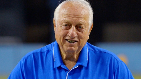 Former Los Angeles Dodgers manager Tommy Lasorda poses with his birthday cake as he celebrates his 88th birthday prior to a baseball game against the Arizona Diamondbacks, Tuesday, Sept. 22, 2015, in Los Angeles. (AP Photo/Mark J. Terrill)