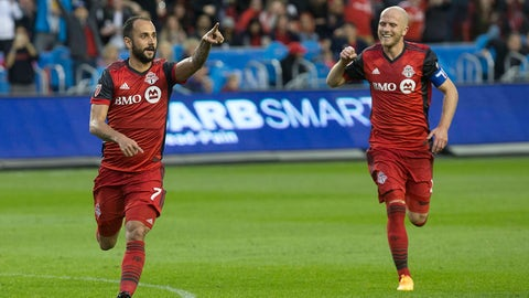 Toronto FC's Victor Vazquez, left, celebrates after scoring his second goal and his team's third against the Columbus Crew as Michael Bradley runs in to congratulate him during second-half MLS soccer game action in Toronto, Friday, May 26, 2017. (Chris Young/The Canadian Press via AP)