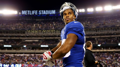 EAST RUTHERFORD, NJ - OCTOBER 21: Wide receiver Victor Cruz #80 of the New York Giants looks on before the start of the second half against the Minnesota Vikings during a game at MetLife Stadium on October 21, 2013 in East Rutherford, New Jersey.  (Photo by Elsa/Getty Images)