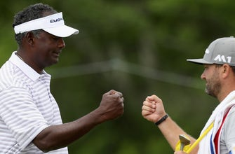 Vijay Singh takes lead with 68 at windy Senior PGA