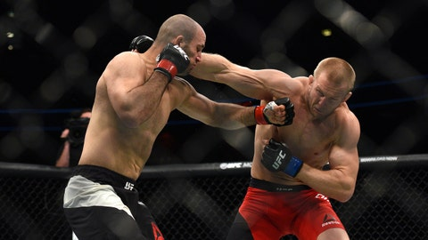 May 28, 2017; Stockholm, Stockholms Lan, Sweden; Volkan Oezdemir (red gloves) fights Misha Cirkunov (blue gloves) during UFC Fight Night at Ericsson Globe. Mandatory Credit: Per Haljestam-USA TODAY Sports