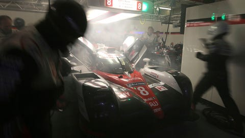 The No. 8 Toyota with smoke billowing out of it during the 24 Hours of Le mans. (AP Photo/David Vincent)