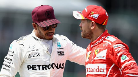 Championship rivals Lewis Hamilton and Sebastian Vettel pictured talking to another at the Canadian GP. (Photo by Mark Thompson/Getty Images)