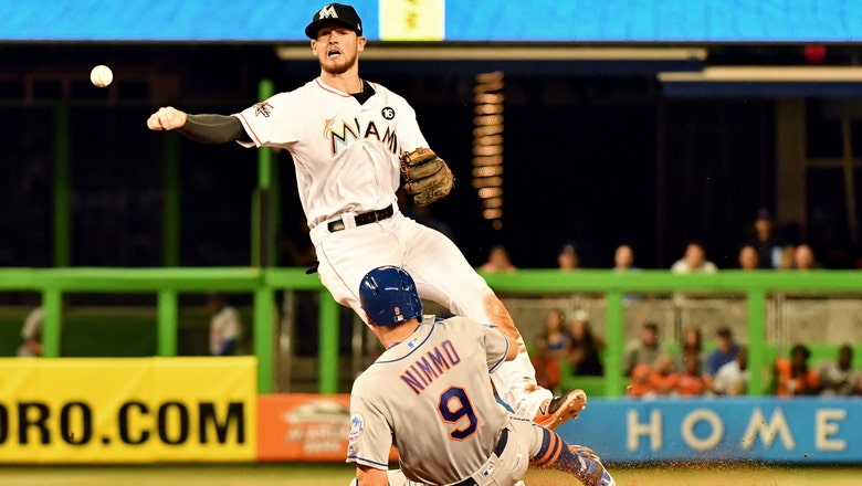 Marlins rally in 7th to take series opener from Mets