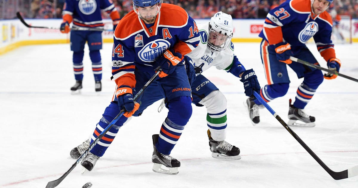 10004525-nhl-vancouver-canucks-at-edmonton-oilers.vresize.1200.630.high.0