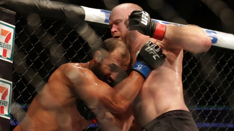 Jun 25, 2017; Oklahoma City, OK, USA; Tim Boetsch (red gloves) fights Johny Hendricks (blue gloves) during UFC Fight Night at Chesapeake Energy Arena. Mandatory Credit: Sean Pokorny-USA TODAY Sports