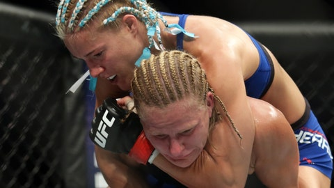 Jun 25, 2017; Oklahoma City, OK, USA; Felice Herring (red gloves) fights Justine Kish (blue gloves) during UFC Fight Night at Chesapeake Energy Arena. Mandatory Credit: Sean Pokorny-USA TODAY Sports