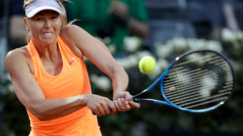 Maria Sharapova, of Russia, returns the ball to Mirjana Lucic-Baroni, of Croatia, during the Italian Open tennis tournament, in Rome, Tuesday, May 16, 2017. (AP Photo/Andrew Medichini)