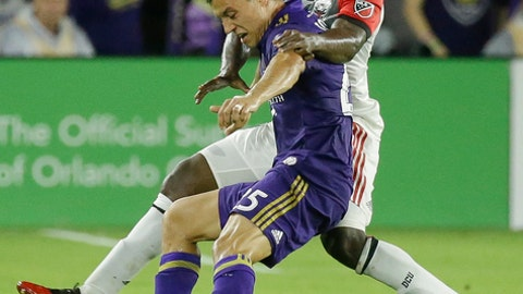 D.C. United's Patrick Nyarko, right, grabs Orlando City's Donny Toia by the arm as they try to get possession of the ball during the second half of an MLS soccer match, Wednesday, May 31, 2017, in Orlando, Fla. Orlando won 2-0. (AP Photo/John Raoux)