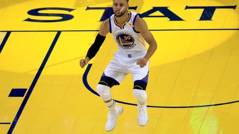 Warriors' Curry taking it game by game after last year's collapse