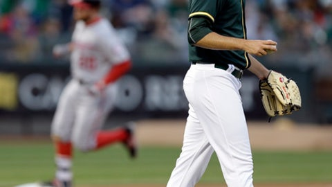 Nationals hold on for 11-10 win over Athletics