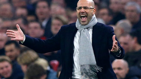 FILE - In this March 16, 2017 file photo Ajax's coach Peter Bosz screams during the Europa League round of 16, second leg, soccer match between Ajax and Kobenhavn at the Amsterdam ArenA stadium in Amsterdam, Netherlands. (AP Photo/Peter Dejong, file)