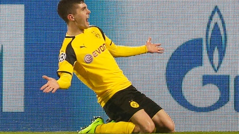 FILE - In this March 8, 2017, file photo, Dortmund's Christian Pulisic celebrates after scoring his side's second goal during the Champions League round of 16, second leg, soccer match against Benfica in Dortmund, Germany. Pulisic is just 18, only he doesn't play like he's just 18. Already the youngest American to win a medal with a European club, Pulisic will now lead the U.S. into an important World Cup qualifier against Trinidad and Tobago on Thursday night, June 8.  (AP Photo/Michael Probst, File)