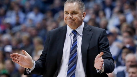Butler head coach Chris Holtmann directs his players from the bench in the second half of an NCAA college basketball game against Xavier, Sunday, Feb. 26, 2017, in Cincinnati. Butler won 88-79. (AP Photo/John Minchillo)