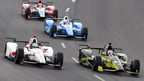 Tristan Vautier (18), of France, pressures Charlie Kimball (83) for the lead going into Turn 1 as Scott Dixon (9) of New Zealand and Alexander Rossi, rear, follow during an IndyCar auto race at Texas Motor Speedway, Saturday, June 10, 2017, in Fort Worth, Texas. (AP Photo/Larry Papke)