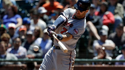 Minnesota Twins&#039 Joe Mauer singles during the fifth inning of a baseball game against the San Francisco Giants Sunday