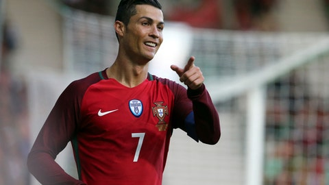 In this photo taken on Tuesday, March 28 2017, Portugal's Cristiano Ronaldo gestures during the international friendly soccer match between Portugal and Sweden at the dos Barreiros stadium in Funchal, Madeira island, Portugal. (AP Photo/Armando Franca)