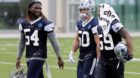 Dallas Cowboys' Jaylon Smith (54), Sean Lee (50) and Anthony Hitchens (59) walk off the practice field after NFL football practice at the team's training facility, Tuesday, June 13, 2017, in Frisco, Texas. Lee is surrounded by uncertainty on a Dallas defense needing improvement to match a dynamic offense that carried the Cowboys to the best record in the NFC last year. The All-Pro linebacker is a pretty good starting point. (AP Photo/Tony Gutierrez)