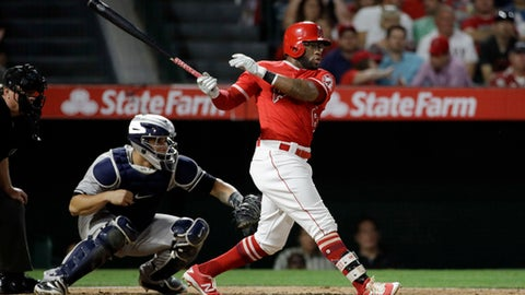 Los Angeles Angels' Eric Young Jr. watches an RBI single during the third inning of the team's baseball game against the New York Yankees, Wednesday, June 14, 2017, in Anaheim, Calif. (AP Photo/Jae C. Hong)