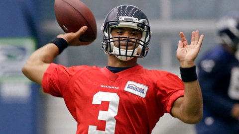 Seattle Seahawks quarterback Russell Wilson throws during NFL football practice Thursday, June 15, 2017, in Renton, Wash. (AP Photo/Elaine Thompson)
