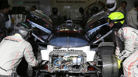 The Porsche 919 Hybrid No2 of the Porsche Team driven by Earl Bamber of New Zealand, Timo Bernhard of Germany and Brendon Hartley of New Zealand stops for repairs during the 85th 24-hour Le Mans endurance race, in Le Mans, western France, Saturday, June 17, 2017. (AP Photo/David Vincent)
