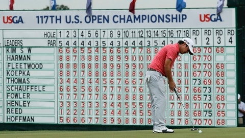 Brian Harman putts on the 18th hole during the third round of the U.S. Open golf tournament Saturday, June 17, 2017, at Erin Hills in Erin, Wis. (AP Photo/A Charlie Riedel)
